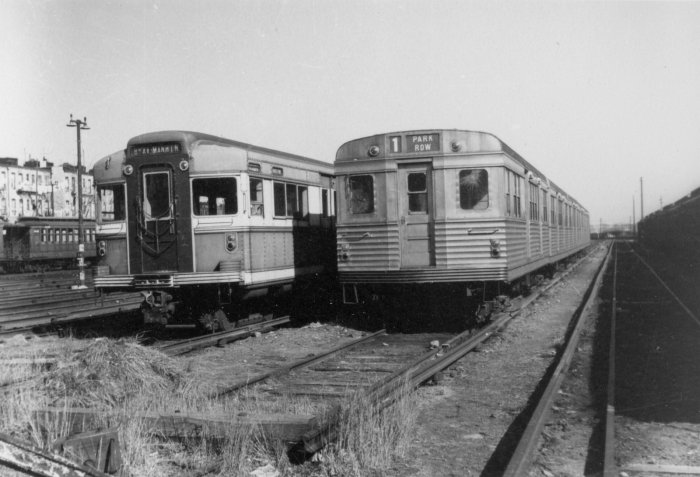 "A 3-section ""Bluebird"" at left in 1956, just prior to scrapping, with a Budd 5-section prototype from 1934-5 awaiting a similar fate (R. E. Jackson photo)"