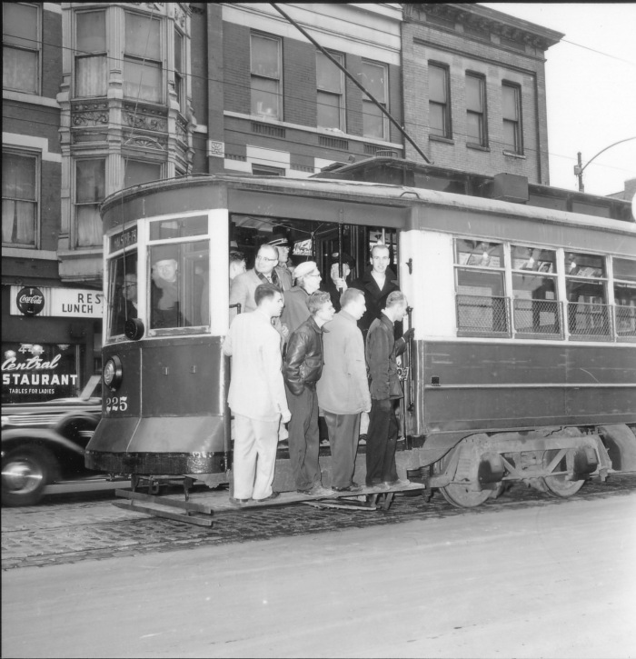Car #225 on Clark Street, on an Illini Railroad Club fantrip, February 10, 1957. No, the car is not moving- this is a posed shot. (CTA Historical Collection)