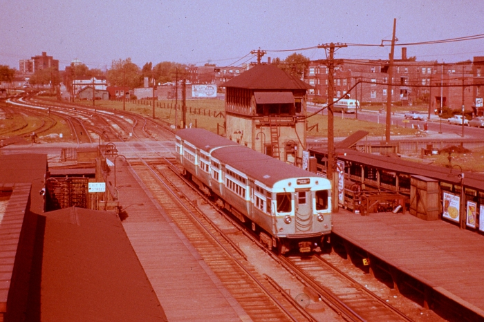 """CTA 6037-6038 heading west at Laramie on a CERA fantrip on May 1, 1955, showing how the line curved off a bit to the south, before straightening out temporarily to cross Lockwood before veering off again to run parallel with the B&O. We have attempted to bring the color back as much as possible in this early Ektachrome slide, which has a very pronounced """"red shift."""" (Photo by Ray DeGroote)"""