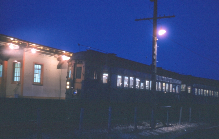 In this nighttime shot, a CA&E train sits at Des Plaines terminal in April 1957. (Photographer unknown)