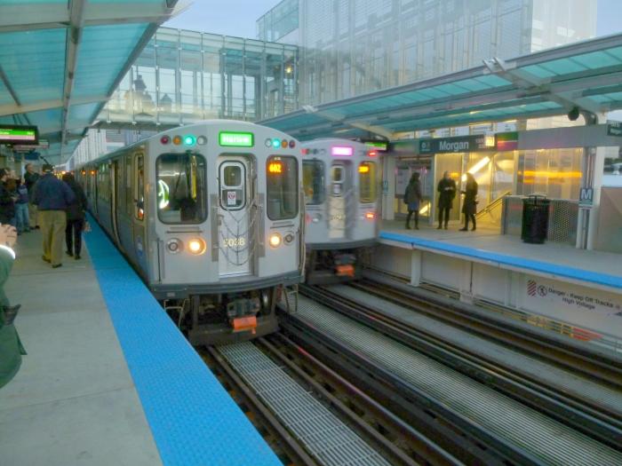 A Pink Line train passes us at Morgan.