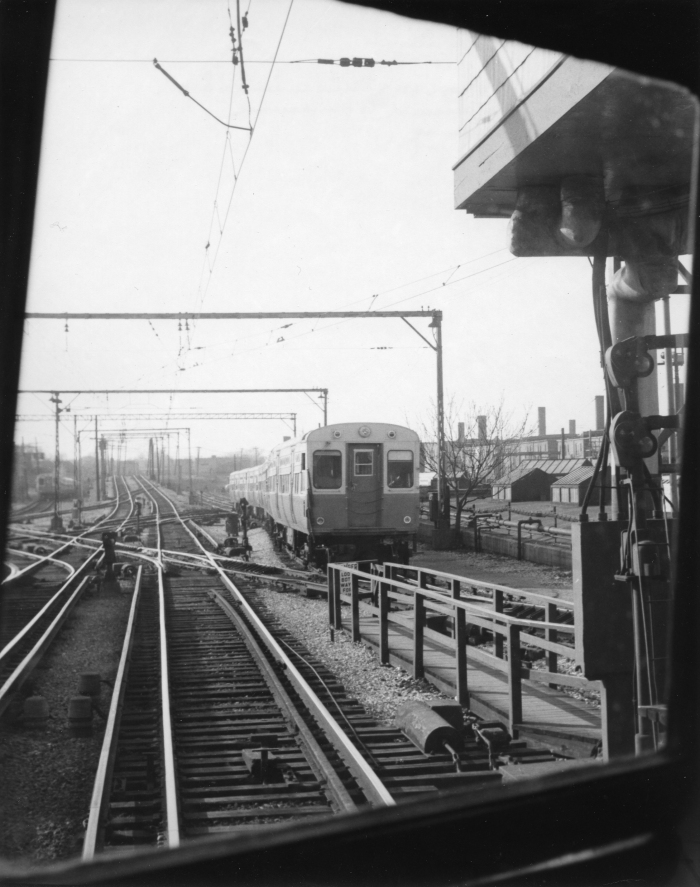 A train of CTA 6000s, as seen from a CNS&M Electroliner, looking north at Howard St., in a photograph by Lawrence H. Boehning, taken on May 8, 1958 (Author's collection).