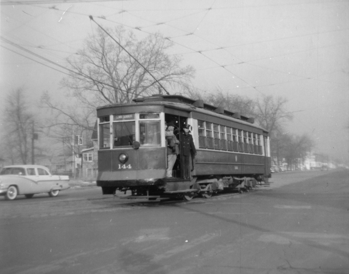 CTA #144 on the 12-29-57 fantrip, at 81st and Vincennes, on Vincennes Avenue looking north (Author's collection)