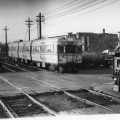 "CTA 5002 westbound at Laramie, December 1947. The four experimental articulated cars were patterned after the earlier BMT ""Bluebirds"" in New York. While they were ordered by CRT in their waning days, the fledgling CTA and the City of Chicago stage-managed this behind the scenes, as they also did with the CSL order for 600 ""Green Hornet"" streetcars. Car 5001 was already on CRT property before CTA took over on October 1, 1947. (Photographer unknown)"