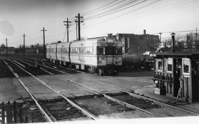 """CTA 5002 westbound at Laramie, December 1947. The four experimental articulated cars were patterned after the earlier BMT """"Bluebirds"""" in New York. While they were ordered by CRT in their waning days, the fledgling CTA and the City of Chicago stage-managed this behind the scenes, as they also did with the CSL order for 600 """"Green Hornet"""" streetcars. Car 5001 was already on CRT property before CTA took over on October 1, 1947. (Photographer unknown)"""