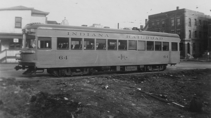 """On the back of the photo, it says, """"Indiana RR lightweight interurban #64. Snapped in Ft. Wayne, April 1, 1939. Color- orange + green roof. Built 1930 by Am. Car Co., Jeffersonville, Ind."""" (Author's collection)"""