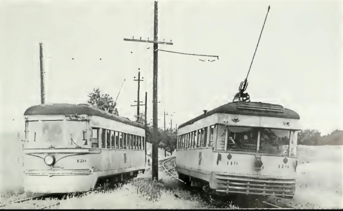IR #65 at left in CRANDIC service, renumbered as #120, with an ex-CLE high-speed at the right (Author's collection)