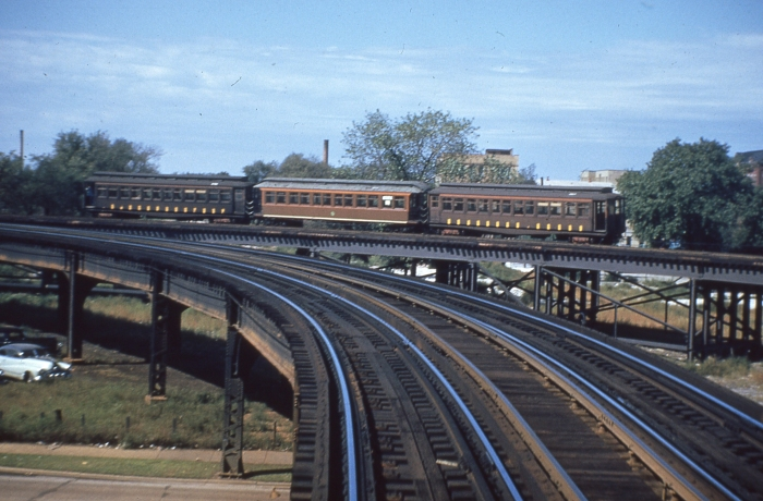 #23 - A three-car wood test train is on the connecting ramp about to descend to ground level. Where did they find the open-platform middle car? Perhaps it was borrowed from Ravenswood. This would be in 1953, before September 20. Answer: September 20, 1953 (Photo by Ray DeGroote)