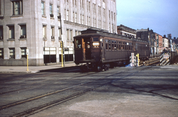 #18 - Two-car Met wood westbound on Van Buren at Ashland Blvd. The building on the northeast corner was a union headquarters and hall. Answer: CTA 2906-2878 at Van Buren/Ashland on November 8, 1953. (Photo by Ray DeGroote)