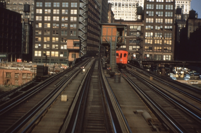 #9 - The newest of the CA&E woods (315?) is seen approaching the throat of the Wells Street terminal on the south of the two-bridge Scherzer rolling lift bridges over the South Branch of the Chicago River. The Market Street connection to the Loop is seen at right. This must be late in the game before September 20, 1953, since the wood is freshly painted and the woods and steel Pullmans were low priority for paint jobs. Answer: East from Canal on August 25, 1953. (Photo by Ray DeGroote)