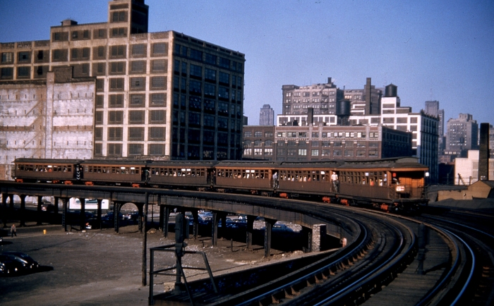 "#8 - The photographer must have loved rush hour Douglas Park woods, an ""A"" train yet, rounding the Halsted curve westbound on the Met mainline in the same time period as the earlier ones. Answer: CTA 2700s at Halsted/Van Buren in May 1952. (Photo by George Krambles)"