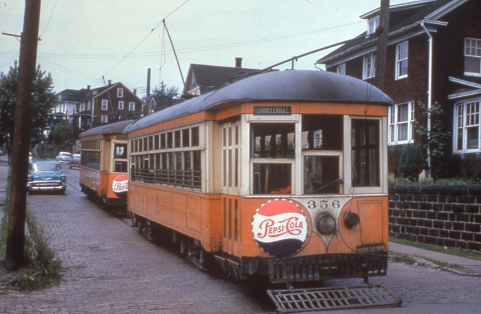 "Those aren't drumheads on these 1950s Johnston PA streetcars, just advertising. ""Pepsi-Cola hits the spot / Twelve full ounces, that's a lot / Twice as much for a nickel, too / Pepsi-Cola is the drink for you"" (Author's collection)"