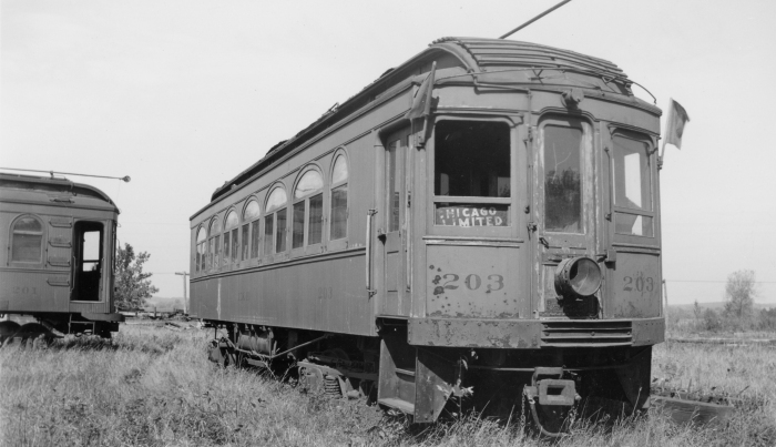 Elgin and Belvidere Electric car 203 sits abandoned in this 1930s photo. I think the photographer added the flags and the lantern to make the picture look better. (Photo by Ed Frank, Jr., Author's collection)