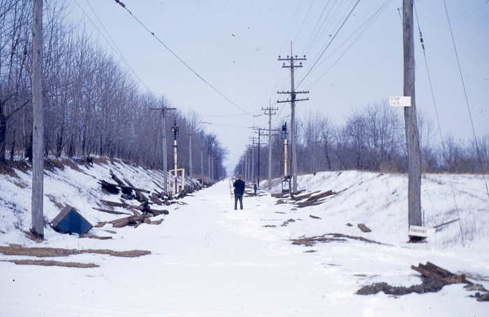 The abandoned right-of-way of the Liberty Bell Limited interurban in Pennsylvania, during the winter of 1951-52. Some of the signals from this line are now in use at the Seashore Trolley Museum in Maine. (Author's collection)