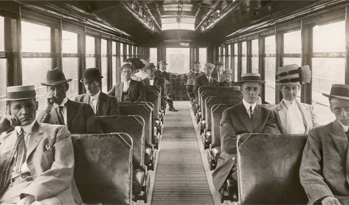 "Riders can express their opinions about CTA ""L"" car seating in a new survey. This crowd, from about 100 years ago, looks like a tough audience, but at least they are all facing forward. (Author's collection)"