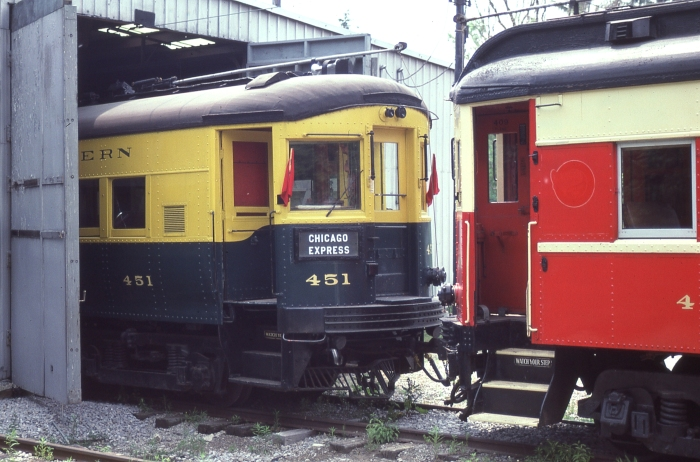 "A 1984 shot of CA&E 451 (with a rather odd color scheme) in Olmstead Township, Ohio on the Columbia Park and Southwestern aka ""Trolleyville USA."" This car is now at the Illinois Railway Museum. (Photo by David Sadowski)"