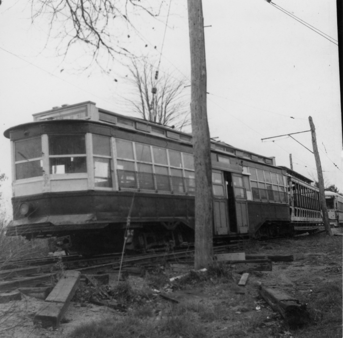 "The Seashore Electric Railway Museum in Maine on October 26, 1955. Ex-Boston Elevated ""drop center"" car 6270 is at the front, while LVT 1030 brings up the rear. (Author's collection)"