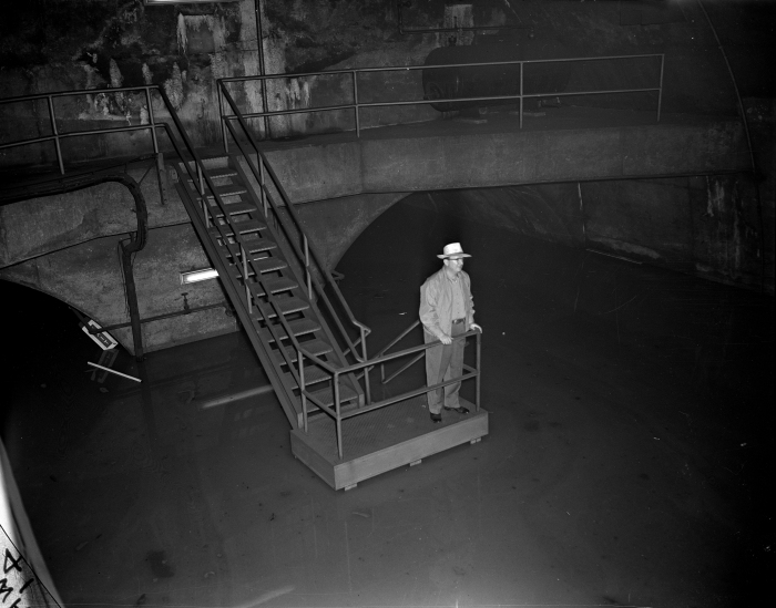 Virgil Gunlock, CTA chairman of the board, looks at the 12 feet of water in the subway at LaSalle and Congress on July 13, 1957. (Editor's collection)
