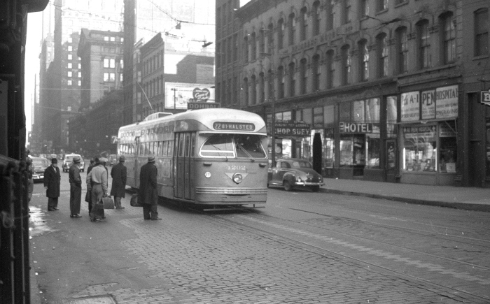 """Frame 10 - """"Postwar Pullman 4202 on Clark southbound approaching Van Buren. with the Federal Building and Old Post Office in the background."""" -GF"""