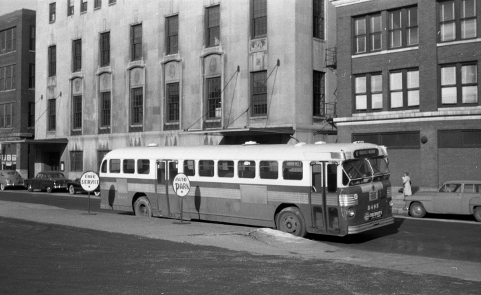 """Frame 14 - """"Bus 5495 as 12-Roosevelt on layover on East 11th Street between Wabash and Michigan."""" -GF """"Fageol Twin Coach propane bus... note Getz Theater building behind bus (Indiana limestone building)."""" -JW"""