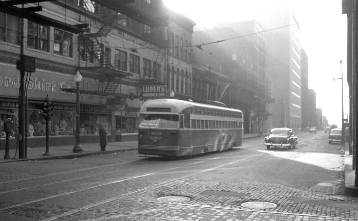 """Frame 11 - """"Postwar PCC 4132 northbound on Clark (at) Van Buren Street (pre-one-way Dearborn Clark pairing)."""" -GF """"Note part of trough under (the) """"L"""" in picture."""" -JW"""