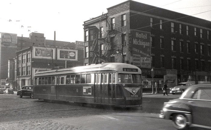 """Frame 18 - Looking southwest from Wabash and Roosevelt. Prewar PCC 4023 is heading northbound. """"Note #38 sign! This is an Indiana sign, but (the) car is obviously on 4-Cottage Grove. Apparently there was no 4 Wabash-Grand sign, but amazing that a PCC would have a sign for Indiana Ave., which could not use PCCs!"""" -AK"""