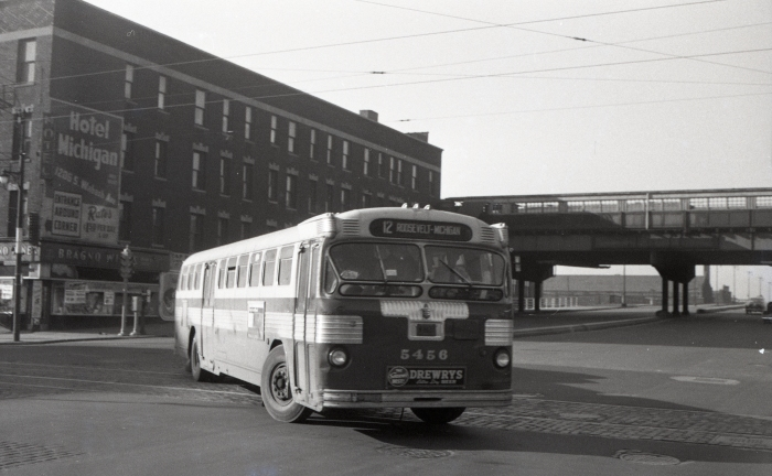 """Frame 17 - """"Bus 5456 as 12-Roosevelt turning from eastbound Roosevelt to northbound Wabash on its terminal loop, 11th, Michigan, and back to Roosevelt. Roosevelt west of Wabash is paved and dewired."""" -GF """"Fageol Twin Coach"""" -JW"""