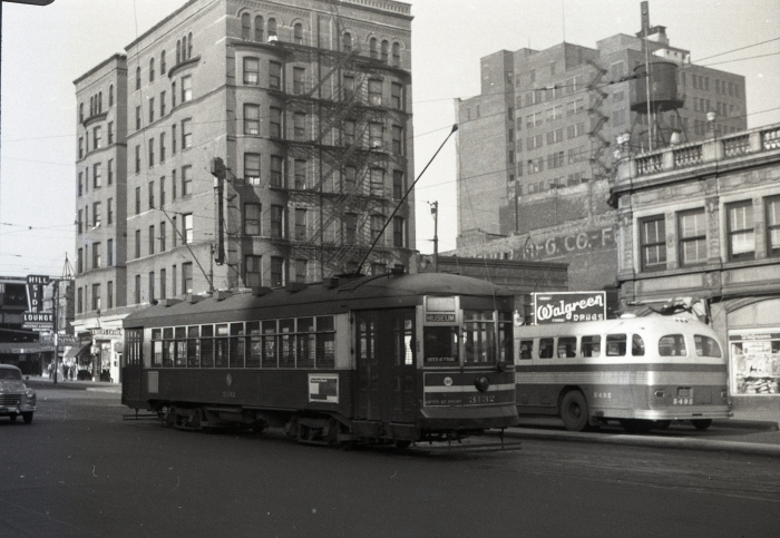 """Frame 15 - """"Red car 3132 on layover at Roosevelt and Wabash as a Roosevelt shuttle. View is looking northwest, with the Roosevelt North Shore Line terminal in the background... Hillside Lounge next to the station."""" -GF """"Roosevelt Road Shuttle to Museum Loop on Route 12A."""" -JW"""