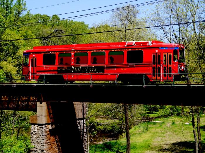 SEPTA LRV 101 on a bridge along the Media trolley line. (Photo by David Sadowski)