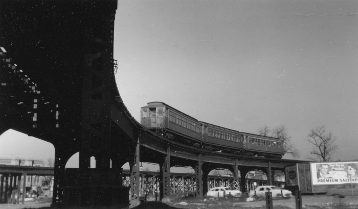 #24 - A three-car Met wood eastbound on the old structure with the temporary structure in the background. A sharp eye will note the Art Nouveau boulevard street lamp on Sacramento behind the old structure. (Photographer unknown)