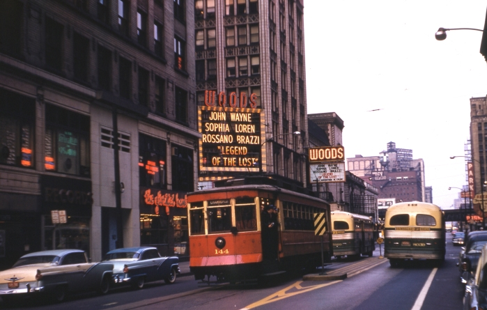 CTA #144 on an Illini Railroad Club fantrip in December, 1957. We are looking north on Dearborn Street near Randolph. We see buses here since by this time, PCCs did not run on weekends on the #22 Clark-Wentworth line. (Author's collection)