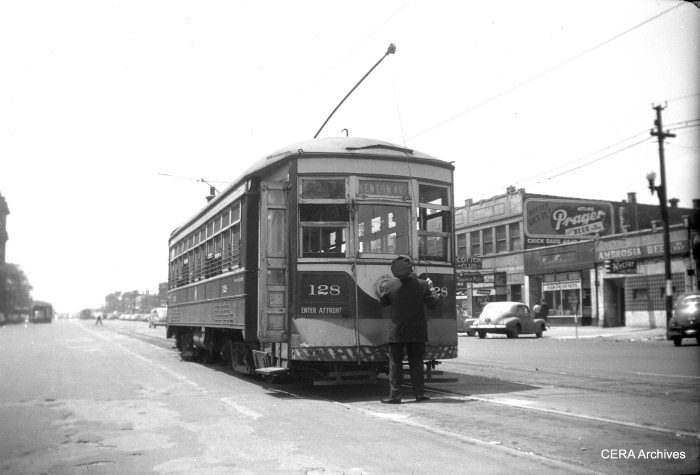 The motorman changes ends on C&WT 128 at Cermak and Kenton, preparing for the return trip west. Passengers heading east would take a Chicago Surface Lines streetcar from this point. Car 128 was built in 1914 by McGuire-Cummings and was scrapped in 1948. (Photo by Norman Rolfe)