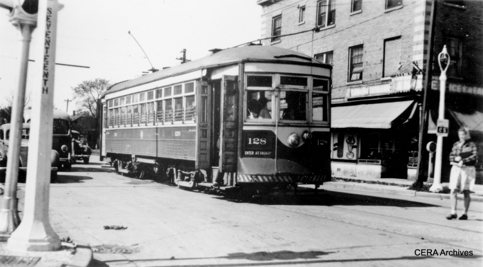 "C&WT 128 at 17th in Maywood in 1945. Built by McGuire-Cummings in 1914, this car was scrapped in 1948. Bill Shapotkin writes, ""Presume the photo of car #128 (at 17th Ave in Maywood) is at Lake/17th? Which direction is the car heading? Whose bus is that at the left?"""