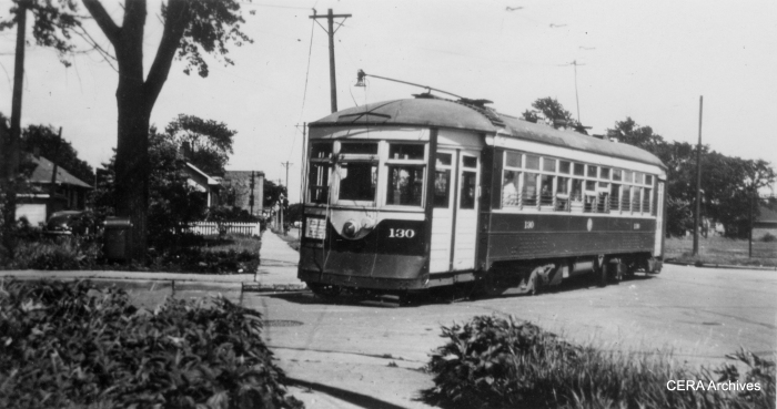 "C&WT 130 in Maywood in 1945. Built by McGuire-Cummings in 1914, this car was scrapped in 1948. Bill Shapotkin writes, ""Presume the photo of car #130 (turning the corner) is at Madison/19th (car is turning from W/B Madison into N/B 19th Ave)?"""