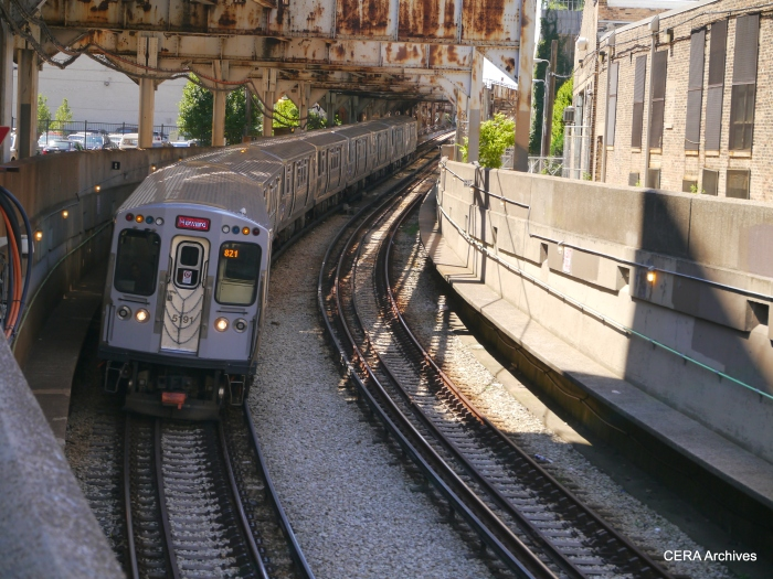 A northbound Red Line train going down the ramp into the State Street subway.