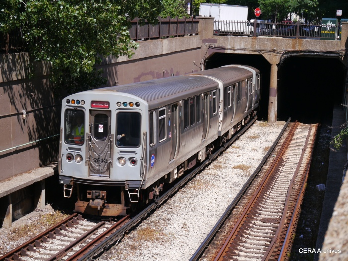 A Red Line train emerges from the subway just south of Roosevelt Road.