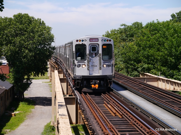 REd Line 5000s heading south at Indiana, near where the Stockyards and Kenwood branches once split off from the main line.