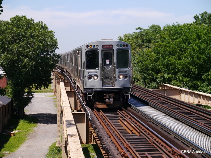 A Red Line train using older equipment heads south at Indiana Avenue.