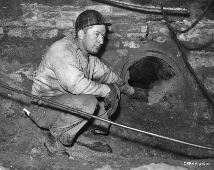 "February 1, 1940 - ""Mike Sunta, 4044 Montgomery, subway worker looking at the old tube where the street car cables traveled through."" (More likely, these were tubes related to the cable car system that preceded streetcars.)"