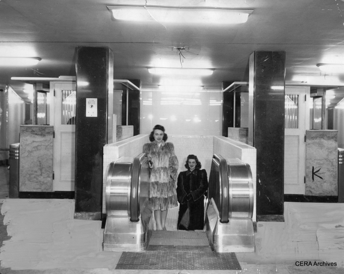 Models in furs pose in the uncompleted subway station at Clark and Division on March 18, 1943. Note the bare wires coming out of the ceiling.