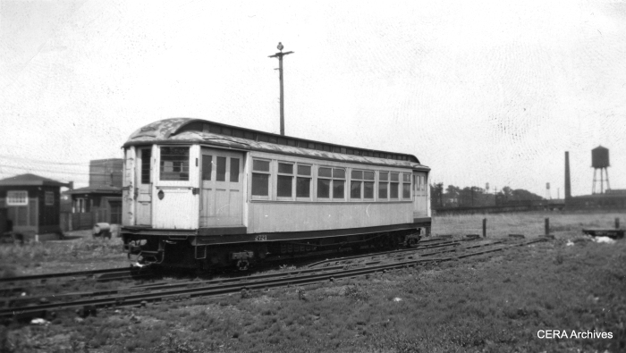 "According to Don's Rail Photos, ""2721 was built by Barney & Smith in 1895 as Metropolitan-West Side Elevated Ry 721. In 1913 it was renumbered 2721. In 1919 it was rebuilt as a merchandise dispatch car to be leased to the North Shore line. After a short time it was replaced by new and similar MD cars built for the North Shore. It was then returned to the CRT and used in work service. It became CRT 2721 in 1923."" It is shown here in 1941 painted silver. This car was scrapped in March 1959. (The location is the SE corner of Laramie Yard. You can see the elevated ramping up at the right of the picture.)"