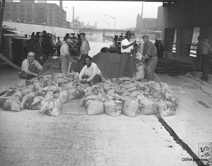 CTA sandbag crew, July 13, 1957. We enjoy having an opportunity to show the real working people of this country, whose contributions are often forgotten or taken for granted.