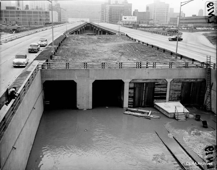 """July 13, 1957: """"Looking EAST on Congress st. expressway, from Halsted st. where the CTA L tracks will leave the expressway, and go underground, and tie in with the subway. Water flows into this section of subway."""" (Photo by Larry Nocerino)"""