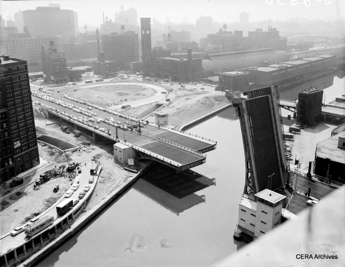"August 3, 1956: ""Twin-bridge across the Chicago River which will open to traffic Aug. 10, when the Expwy. itself will be open to the public from Ashland Ave. to Michigan Ave. New type of device permits the bridgetenders to see clearly whether the bridge is fully closed or partly open even during the densest fog or on the darkest night."" (Photographer unknown)"