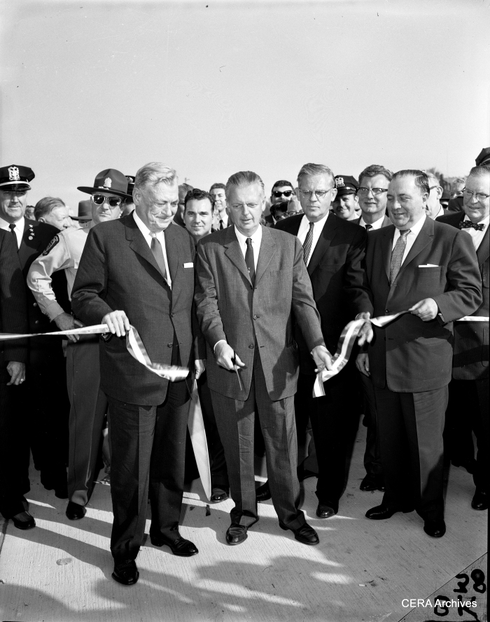 Opening the last section of the Congress expressway, 1960. Gov. William Stratton cuts the ribbon, while Cook County Board President Dan Ryan, Jr. and Mayor Richard J. Daley look on. (Photographer unknown)