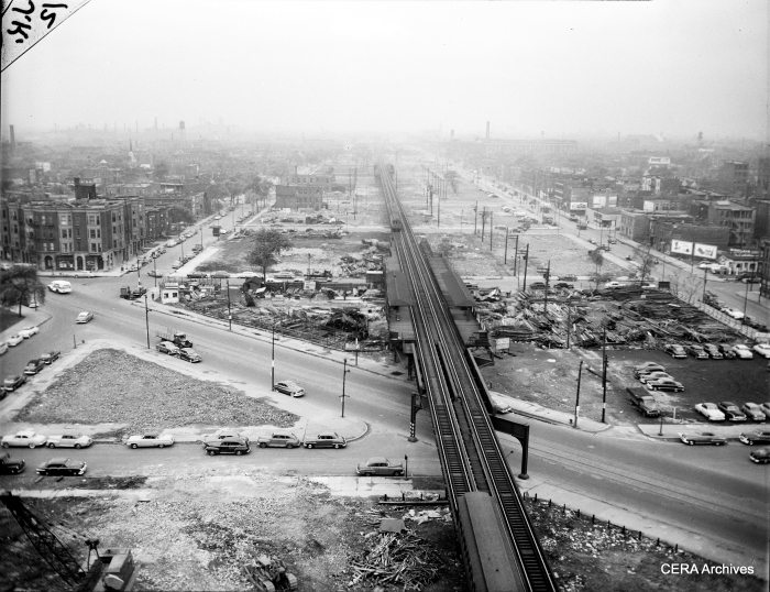 """May 8, 1952: A three-car CA&E train, heading eastbound, is closely following a CTA Garfield Park """"L"""" train. According to Graham Garfield's excellent www.chicago-l.org web site, CA&E trains """"began stopping at Ogden station eastbound during the CTA® era, rather than at Marshfield, at the request of the Authority to clear up delays at Marshfield Junction. This lasted until the CA&E suspended service east of Desplaines on September 20, 1953."""" The Ogden station closed one week later, as CTA trains were rerouted to Van Buren street at first only in one direction. (Photo by Joe Kordick)"""