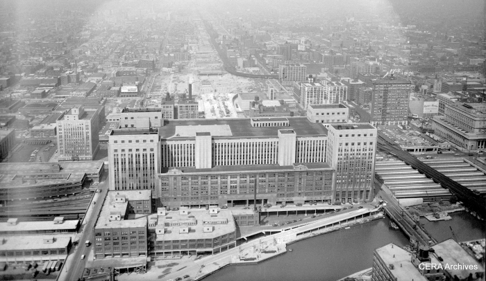 "August 11, 1953: ""The Congress St. Super Highway. Looking West from above the Post Office."" The Garfield Park ""L"" snakes around at right. As you can see, a space has been cleared for the highway in the middle of the old Main Post Office, but the bridge over the Chicago River has not yet been built. (Photo by Bob Kotalik)"