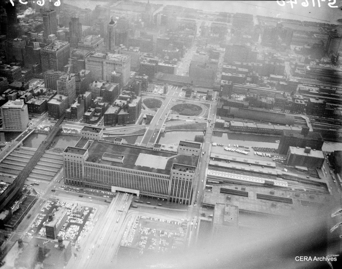 "An aerial view taken on June 6, 1957. By this time, the expressway was open as far as Laramie. The Garfield Park ""L"" is at left. (Photographer unknown)"