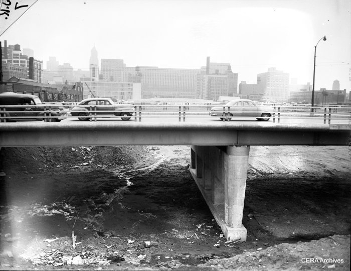 Some of the earliest work on the expressway involved digging out and building overpasses. That way, roads could be diverted around the affected area. (Photographer unknown)