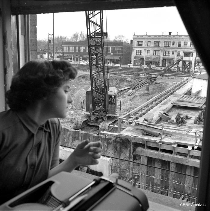 Watching expressway construction in Oak Park in 1959. By now, both the B&O freight line  and the CTA rapid transit line are still running on the surface, but in a temporary alignment at the north end of the highway footprint. (Photographer unknown)